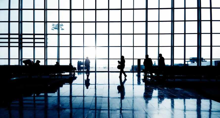 silhouette of people walking inside building