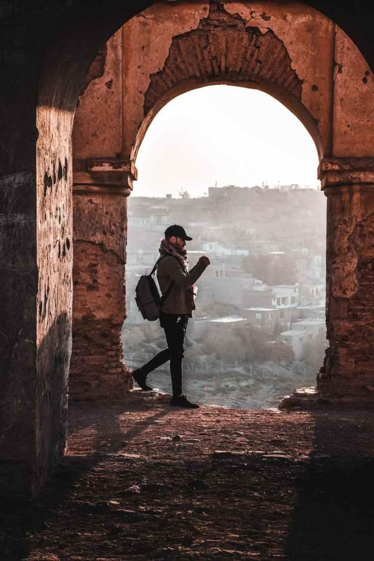 man standing under arch