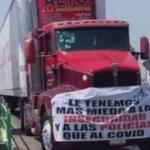 Se manifiestan transportistas sobre la 57 pidiendo seguridad y apoyos ante pandemia