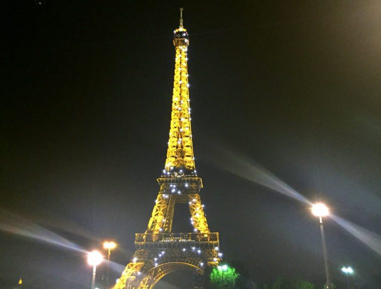 Eiffel Tower at night shinning