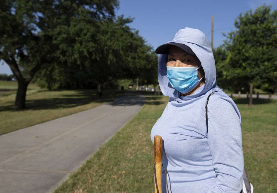 Carol Cruz wears a mask to exercise with her husband on the trail Monday, April 27, 2020, at White Oak Bayou in Houston. Harris County Judge Lina Hidalgo's order to wear face masks in public went into effect Monday. Cruz said she's been wearing masks in the public since the coronavirus outbreak because her daughter, who is a registered nurse, told her to take the virus seriously. Photo: Yi-Chin Lee, Houston Chronicle / Staff Photographer / © 2020 Houston Chronicle