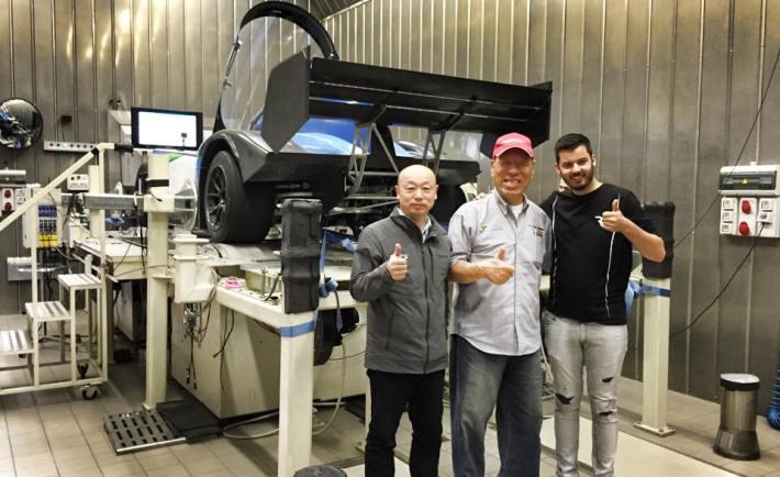 Yutaka Awazuhara, Monster Tajima and Mate Rimac in front of their Pikes Peak challenger.