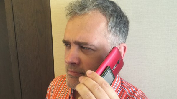 Mr. Nebojsa Novakovic, VR World's co-founder and publisher caught in a rare moment where he holds the phone next to his ear.