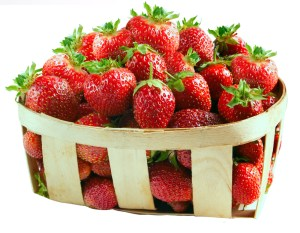 Basket with fresh strawberries isolated on white background.