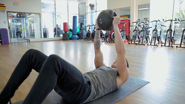 Straight Arm Crunch   At Home Medicine Ball Ab Workout