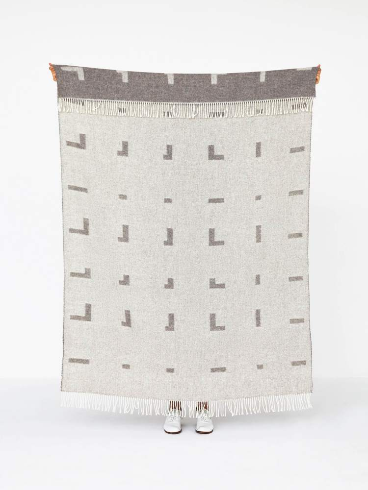 Newly released Iota Blanket in Wool and Alpaca by Halstrøm-Odgaard. In Wool and Alpaca for the Danish company Skagerak. The pattern is inspired by the tiny gaps there are between threads when weaving.