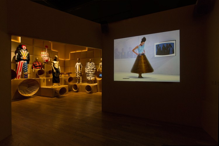 Resistance and Form. The Hussein Chalayan film, the table skirt is displayed in the room.