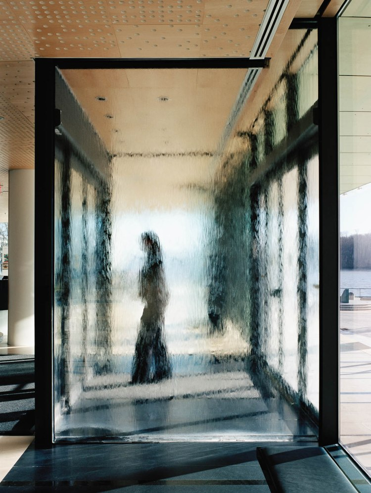 Glass Walls with running water, Swedish Embassy, House of Sweden in Washington D.C. Ingegerd Råman's first collaboration with Swedish Architect Gert Wingårdh, where she was responsible for the artistic treatment of the building. Photo: Michael Perlmutter.