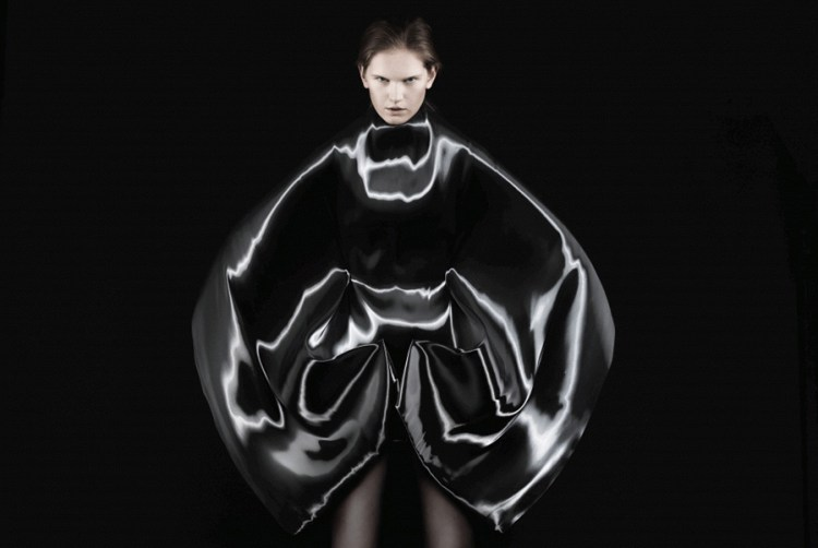 Iris Van Herpen - Micro-2012 couture dress handmade from night blue liquid fabric photo: Ronald Stoop