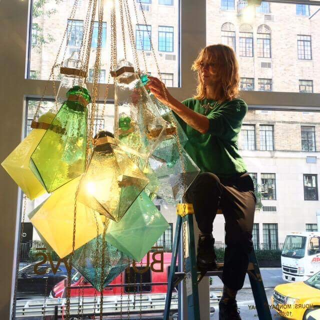 Swedish Artist Frida Fjellman installs her stunning Glass Chandelier at the Manhattan Gallery Hostler Burrows. Photo: Hostler Burrows.