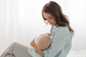 mother breastfeeding or holding baby