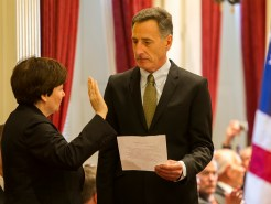 Gov. Peter Shumlin swears in Beth Pearce as state treasurer. Photo by Roger Crowley