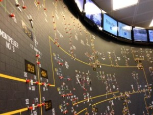 A map on the wall in Green Mountain Power's control room can spot power outages at intersections in their service territory. Photo by John Herrick/VTDigger