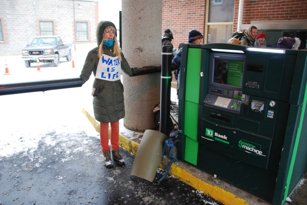 A protester outside TD Bank in Montpelier. VTDigger Photo by Jasper Craven.