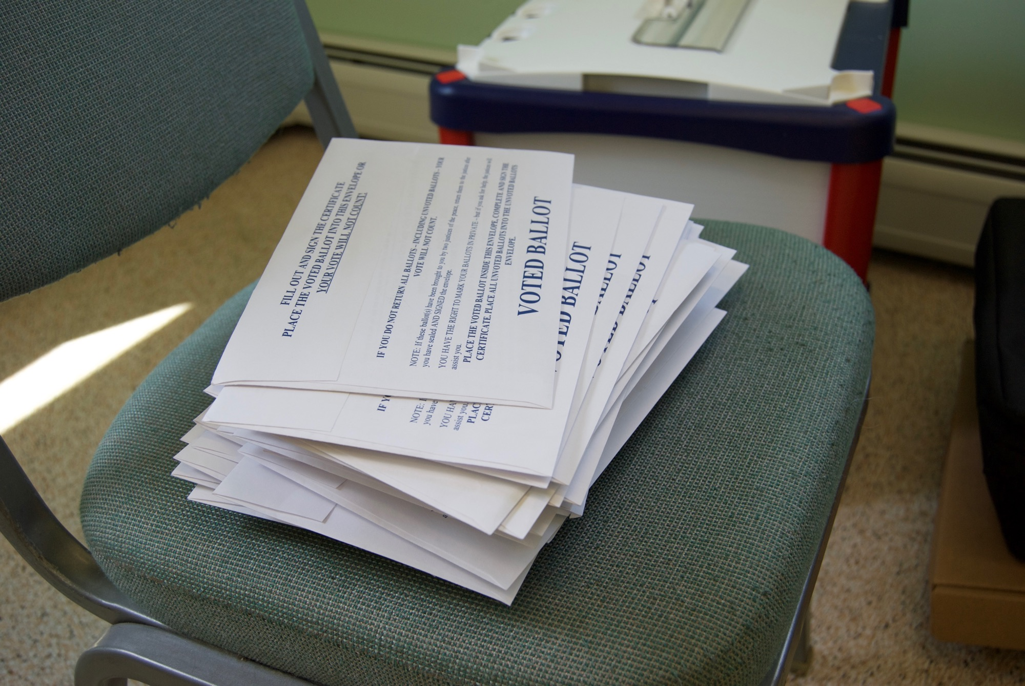 Primary ballots wait to be counted at a polling place in Sunderland's town office Tuesday. Photo by Emma Cotton/VTDigger