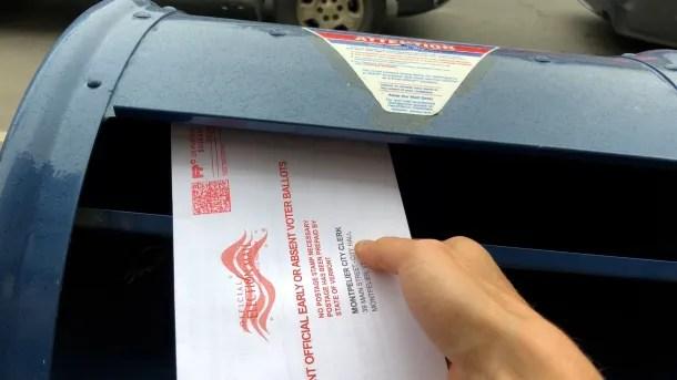Ballot going into mailbox