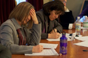 House Appropriations Chairwoman Martha Heath, left, and Mitzi Johnson, D-Grand Isle-Chittenden, take notes during Tuesday's hearings. Photo by Josh Larkin.