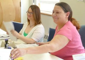 Workers at the Eligibility Benefits Center in Waterbury sort through applications.