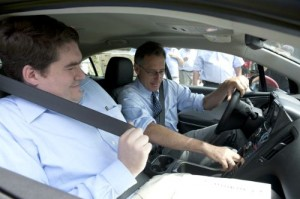 Rep. Oliver Olsen, left, goes on a test drive of a Chevy Volt with Gov. Peter Shumlin at the wheel at the Grand Opening of Green Mountain Energy in South Londonderry Vermont. Photo courtesy of Fran Janik.