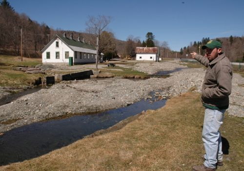 Roxbury Fish Hatchery supervisor Jeremy Whalen of Duxbury shows where five scenic fish rearing ponds once housed some 80,000 trout. Tropical storm Irene washed most of them away and left behind a rubble field of gravel on Aug. 28, 2011. The state has just gone out seeking bids to restore the 1891 hatchery, Vermont's first and a historic site. Photo by Andrew Nemethy