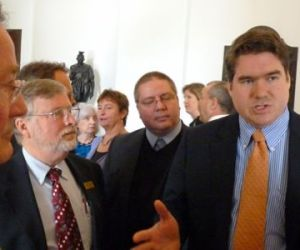 "Rep. Oliver Olsen, right, explains his position on the ""fair share"" bill. Photo by Anne Galloway"