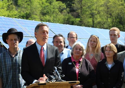 Gov. Peter Shumlin gives a speech with lawmakers and renewable energy advocates at a bill signing in East Montpelier.