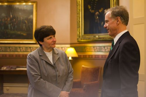 Beth Pearce and Howard Dean at the Statehouse last year. Photo by Nat Rudarakanchana