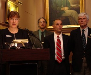 Rep. Linda Waite-Simpson, left, talks about H.124, a bill that would close the gun show loophole and puts state statutes in place that mirror federal laws that prohibit felons, forensic mental health patients and convicted domestic violence abusers from possessing guns. To her right: Reps. Michael Mrowicki, Adam Greshin, and Mike Yantachka. Photo by Nat Rudarakanchana