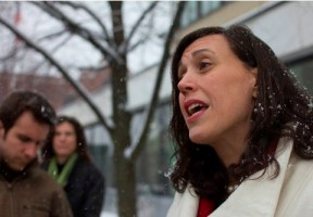 Vermont Law School professor Cheryl Hanna discusses the importance of the court case, the first filed under the state's Equal Pay Act, in front a Burlington courthouse on March 19, 2013. Photo by Nat Rudarakanchana
