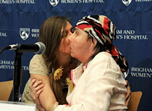 Carmen Tarleton gets a kiss from Marinda Righter, the daughter of the donor, during yesterday's news conference in Boston. Valley News photo by  Jennifer Hauck