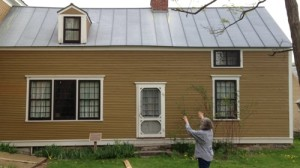 """""""Rokeby Museum director Jane Williamson shows a visitor a wing of the Rokeby farmhouse in Ferrisburgh where escaped slaves lived while working on the farm. Photo by Candace Page"""