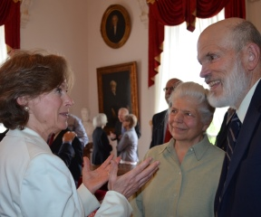 Sen. Claire Ayer and Bob Ullrich,  an active proponent of physician-assisted death, talk after Gov. Peter Shumlin signed into law a bill allowing terminally ill patients to obtain a lethal dose of medication. Photo by Alicia Freese/VTDigger