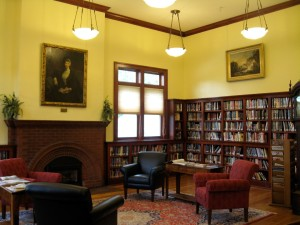 The Morristown Centennial Library has a new addition, but it reflects the soft colors; inviting reading rooms, including a fireplace; and gleaming wood trim of the original interior, seen here.  Photograph courtesy of Nancy Price Graff