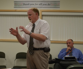 DCF Commissioner Dave Yacovone addresses advocates at a meeting at the Agency of Human Services Tuesday. Deputy Commissioner Richard Giddings is sitting behind him. Photo by Alicia Freese/VTDigger
