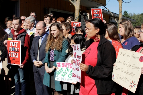 Lindsay DesLauriers,(in green) director of the Vermont Paid Sick days campaign, stands among supporters at a news conference at Red Hen Bakery in Middlesex on Thursday. Photo by Viola Gad/VTDigger