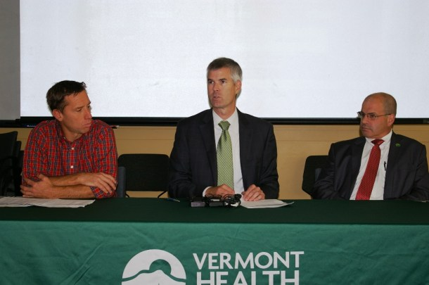 Commissioner of Vermont Health Access Mark Larson (center) addressed reporters questions about Vermont Health Connect in Winooski on Tuesday. At left is Peter Sterling of the Campaign for Vermont Health Care Security and at right is Lawrence Miller, Secretary of Commerce and Community Development. Photo by Andrew Stein/VTDigger
