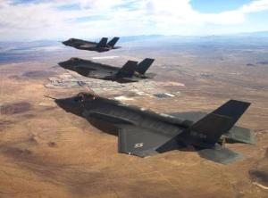 Three F-35A test aircraft, AF-2, AF-3 and AF-4, fly in formation over Edwards Air Force Base, Calif. Lockheed Martin photo
