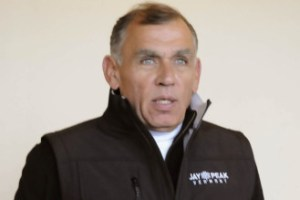 Ariel Quiros stood briefly after the opening of Jay Peak Resort's Stateside Hotel to announce he had purchased the company bringing light plane manufacturing to the state-owned Newport State Airport. Photo by Hilary Niles/VTDigger.
