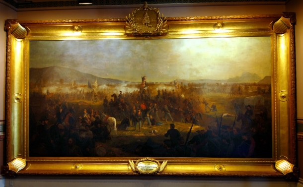 """After the Civil War, war memorabilia began to take over the Statehouse. Nothing demonstrates this more clearly than Vermont artist Julian Scott's magnificent painting """"The Battle of Cedar Creek."""" Purchased by the state in 1874, the painting originally hung in the Executive Room, the only room in the building with a wall large enough to accommodate the 10-by-20-foot piece of art. Later, in the 1880s, when the Statehouse was remodeled, the painting was moved to the Reception Room, eventually called the Cedar Creek Room, where it remains the most spectacular work of art in the building. Photo courtesy of Vermont State Curator's Office."""