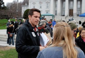 James Haslam, director of the Vermont Workers Center, participates in a May Day rally at the Statehouse. Photo by John Herrick/VTDigger