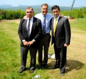 Q Burke owner Ariel Quiros (left) is joined by Gov. Peter Shumlin and Quiros' son, Ary, at a groundbreaking ceremony for Q Burke Resort's new hotel. Photo by Hilary Niles/VTDigger