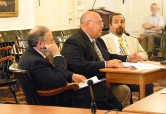 From left, Mental Health Commissioner Paul Dupre, deputy commissioner Frank Reed and medical director Jay Batra testify at a House Mental Health Oversight Committee meeting Tuesday. Photo by Katie Jickling/VTDigger