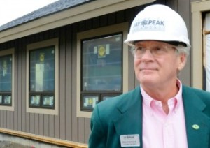 Bill Stenger stands before the future Stateside Hotel at Jay Peak in September 2013. File photo by Hilary Niles/VTDigger