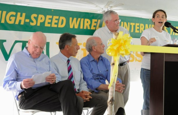 VTel vice-president Diane Guité speaks at a ribbon-cutting ceremony in Hardwick. (Right to left:) Her father, VTel president Michel Guité, Rep. Peter Welch, D-Vt., Gov. Peter Shumlin and Sen. Patrick Leahy, D-Vt., look on. Photo by Hilary Niles/VTDigger