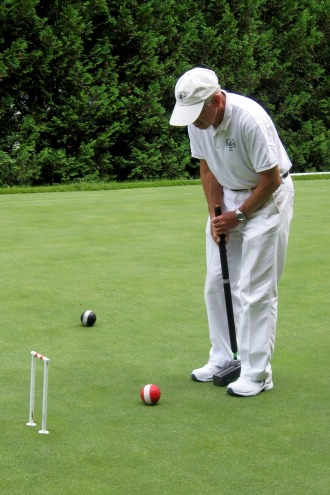 The Croquet Club of Vermont practices every Wednesday afternoon and Saturday morning at the Woodstock Country Club. Ephraim Schulman, lining up for a shot, joined the croquet club in 1998 and has been practicing to lower his handicap ever since. Photo by Nancy Price Graff