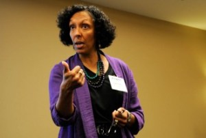 """Cynthia Parker, of the Interaction Institute for Social Change, in Massachusetts, led about 40 Farm to Plate gathering attendees on a """"deep dive"""" session about justice and equity in the food system. Photo by Hilary Niles/VTDigger"""