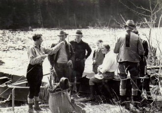 Mrs. Edson, believed to have been a fishing guide, shows guests how to string up a fly rod in this undated photo. Photo courtesy of Quimby Country archive