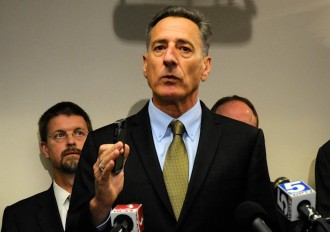 Gov. Peter Shumlin holds up a cell phone to emphasize the viability of the semi-conductor manufacturing business that takes place in Essex Junction. IBM announced Monday it would sell the division to California-based, Abu Dhabi-owned GlobalFoundries. Photo by Hilary Niles/VTDigger