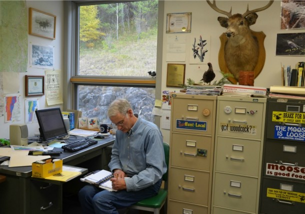 Vermont wildlife biologist and moose expert Cedric Alexander works in his office in St. Johnsbury, where he has spent more than two decades overseeing the species for the Fish & Wildlife Department.  The last few years Alexander has grown concerned about the declining health and future of the moose herd, which is under stress in all of the Northeast. Photo by Andrew Nemethy