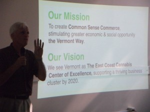 Gardener's Supply Co. founder Will Raap is silhouetted by a Vermont Cannabis Collaborative slide show in Brattleboro on Monday promoting state legalization of marijuana. Photo by Kevin O'Connor/for VTDigger